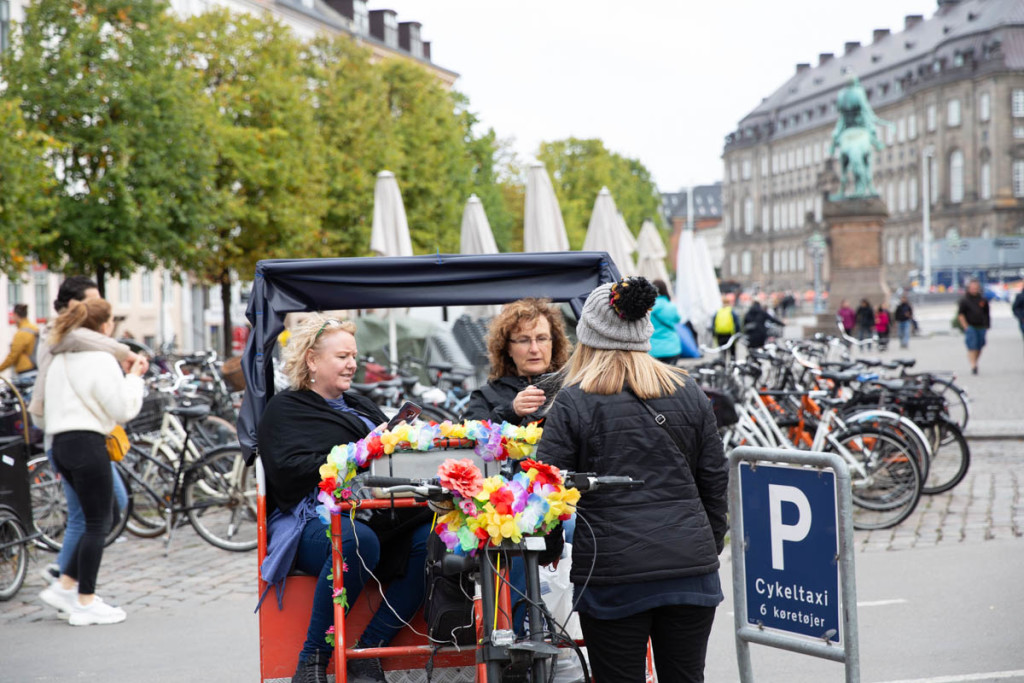 These two lovely ladies sitting comfortably on a rickshaw ala Denmark probably had quite a fun ride