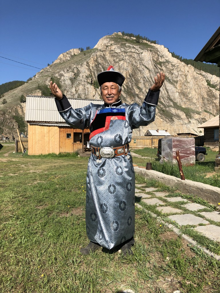 Volodya clad in his full Buryat outfit came out to see us off