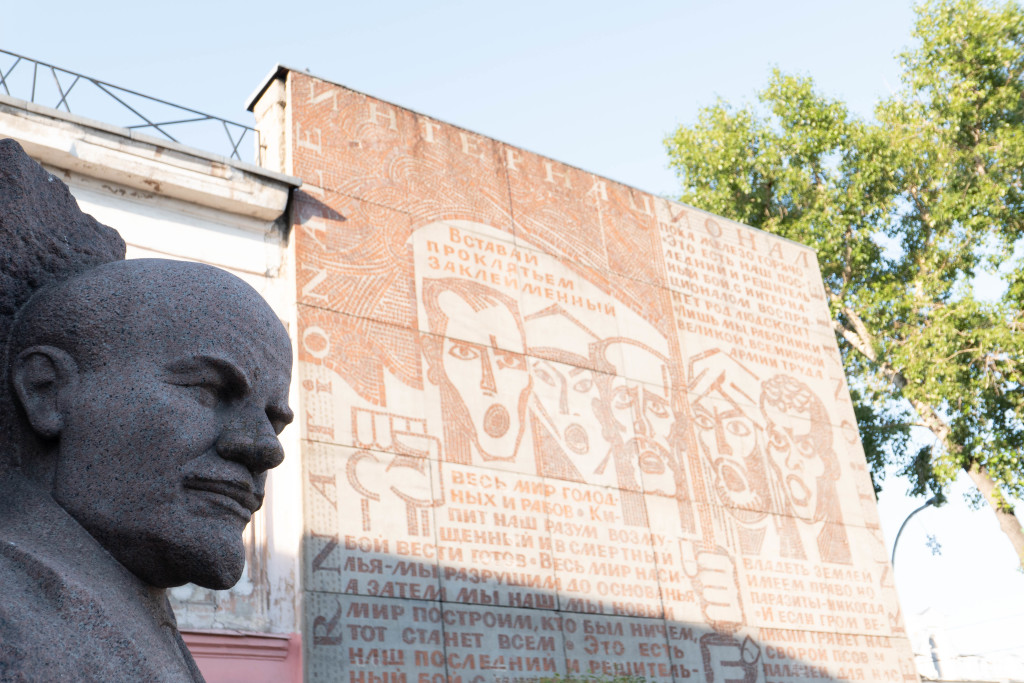 Lenin square. Lenin and The Internationale on the wall next to him.